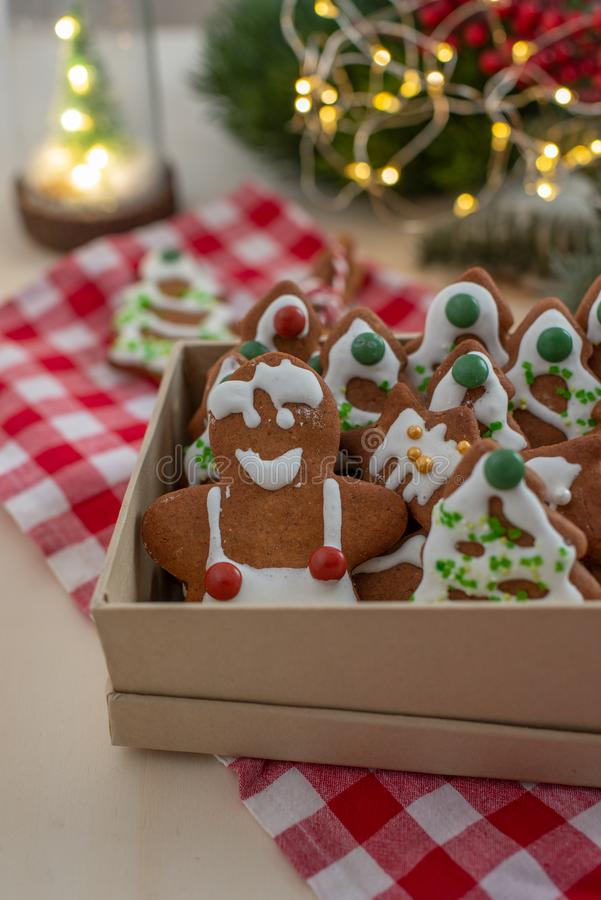 Home made Christmas gingerbread man cookies with a festive background. On a table stock image