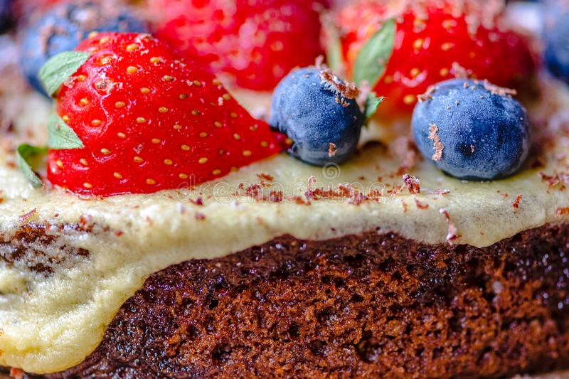 Happy Birthday, Home made cooked vegan chocolate cake with strawberry and blueberries on top royalty free stock images
