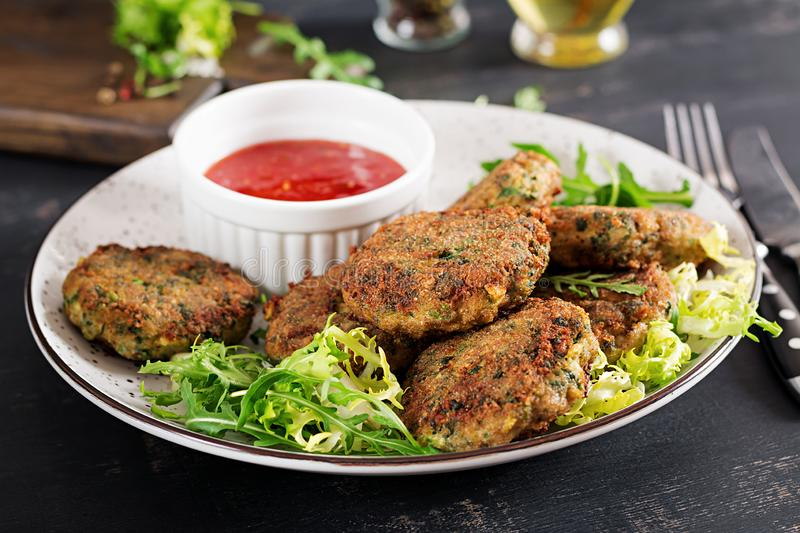 Home made Fish Cake cod, spinach and breadcrumbs. Served on plate with sauce. royalty free stock photos