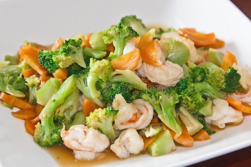 Home made food stir fry vegetable. Asian home made stir fry vegetable with big prawns royalty free stock images