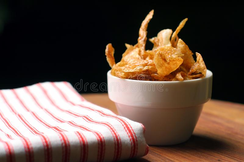 Home-made french fries and napkin royalty free stock image