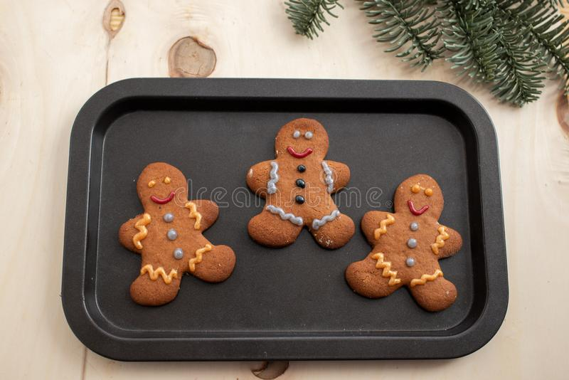 Home made gingerbread man cookies. With a festive background on a table stock photos