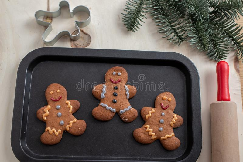 Home made gingerbread man cookies. With a festive background on a table royalty free stock image