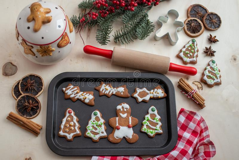 Home made gingerbread man cookies. With a festive background on a table royalty free stock photography