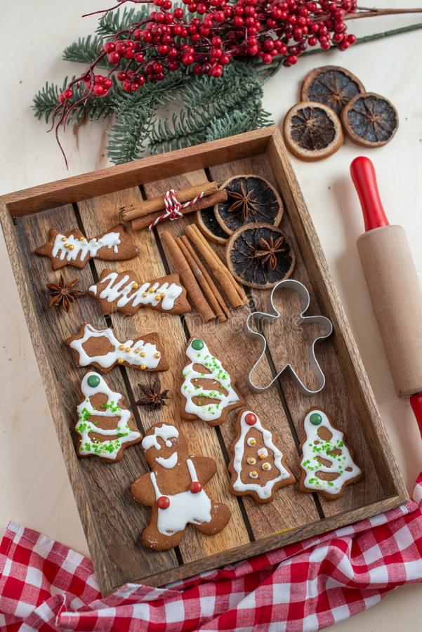Home made gingerbread man cookies. With a festive background on a table stock photo