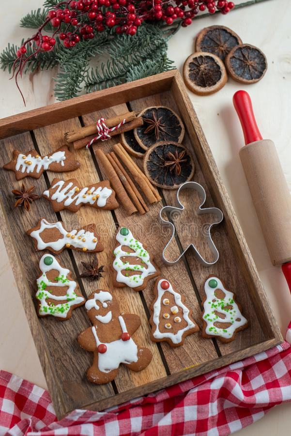 Home made gingerbread man cookies. With a festive background on a table stock image