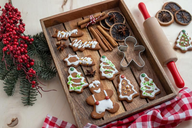 Home made gingerbread man cookies. With a festive background on a table stock photography