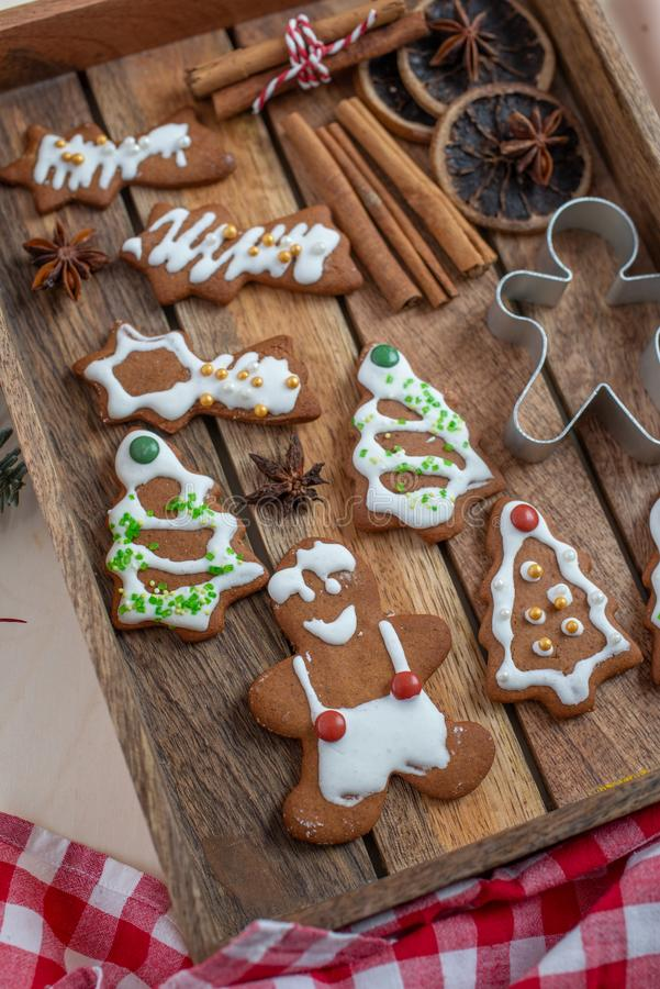 Home made gingerbread man cookies. With a festive background on a table royalty free stock images