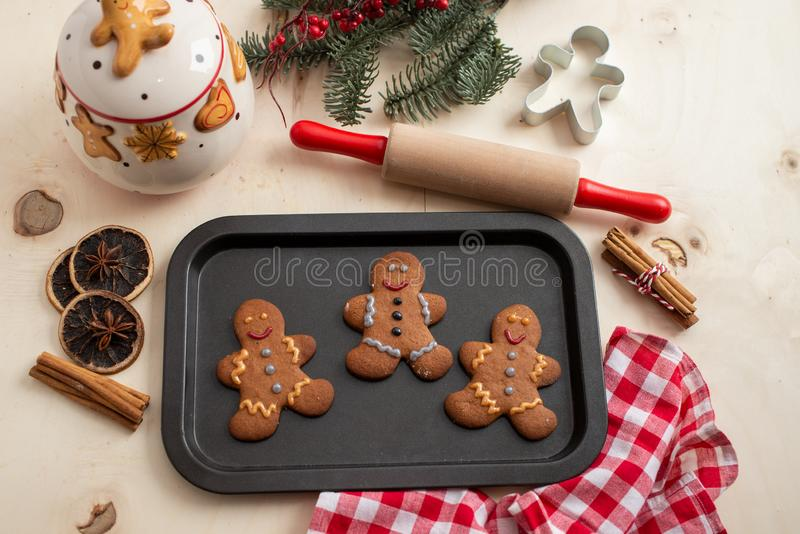 Home made gingerbread man cookies. With a festive background on a table stock images