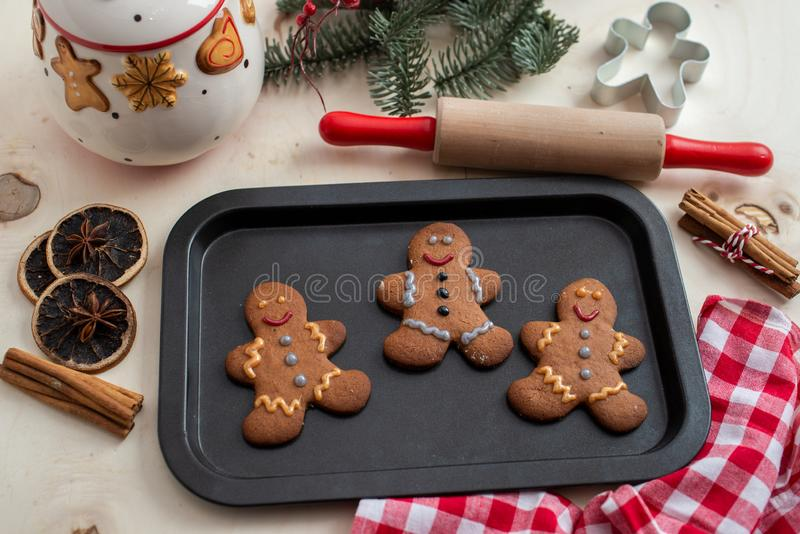 Home made gingerbread man cookies. With a festive background on a table royalty free stock photos