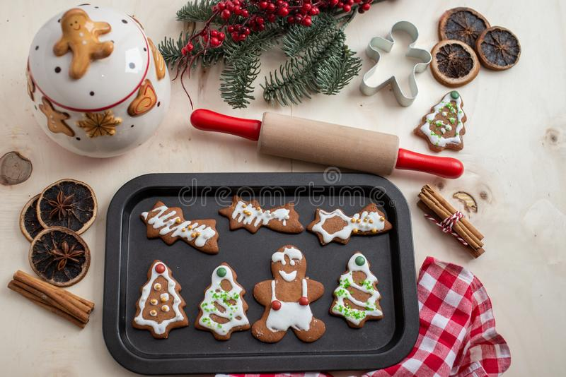 Home made gingerbread man cookies. With a festive background on a table royalty free stock photo