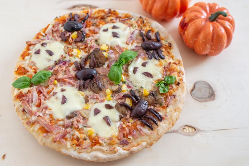 Home made Halloween pizza with ghosts and spiders stock image