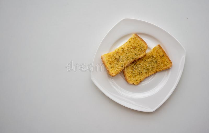 Home made Herb and Garlic Bread on white ceramic plate isolated. On white background. Top view stock photos