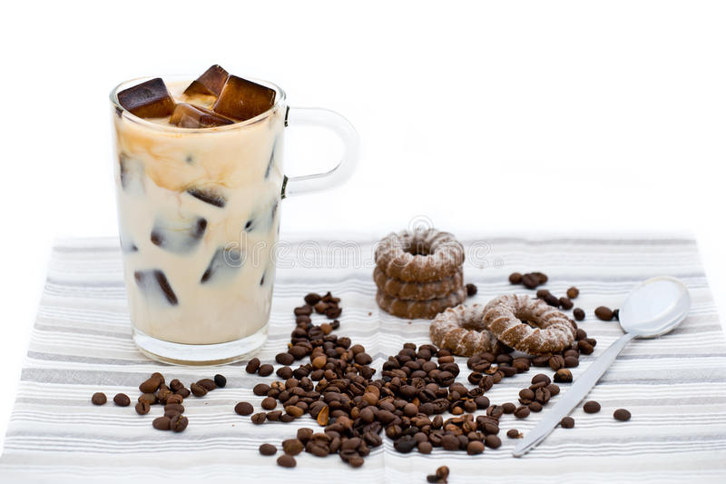 Home-made ice coffee with coffee beans and biscuits stock photos