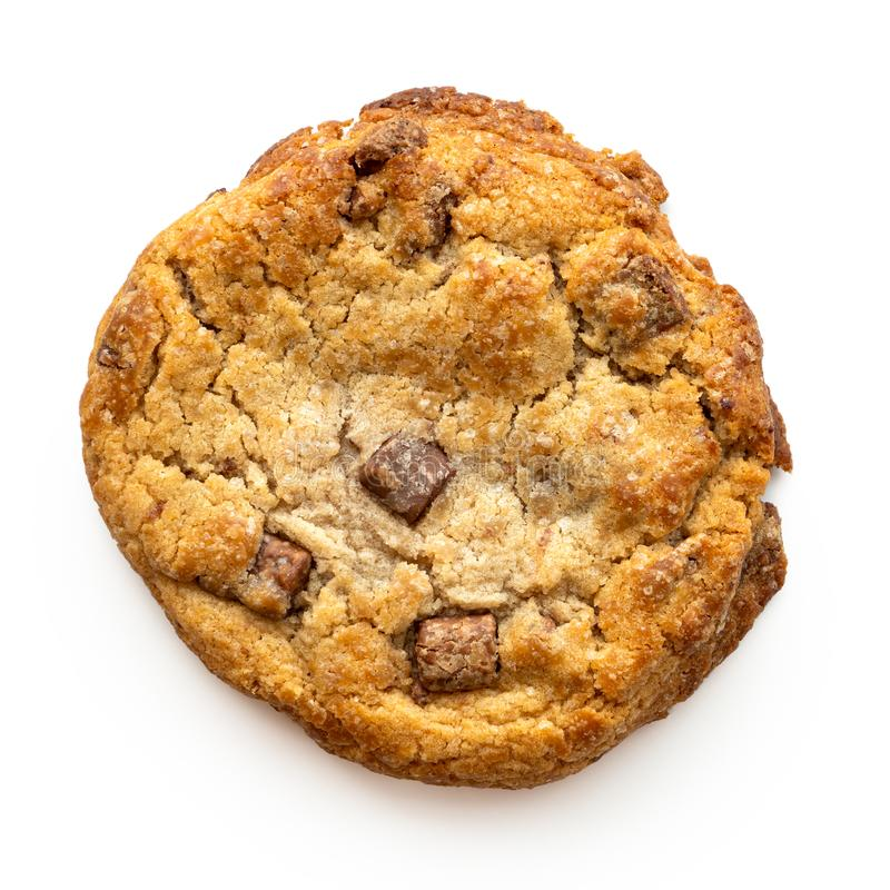 Home made light brown chocolate chip cookie isolated on white from above.  stock images