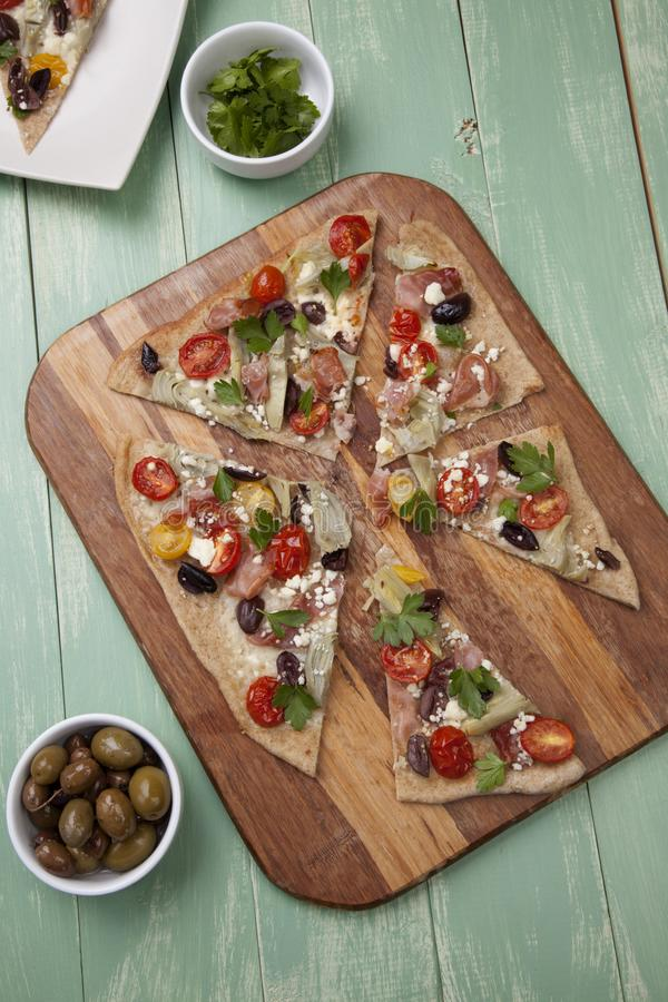 Home Made Mediterranean Prosciutto Flatbread royalty free stock image