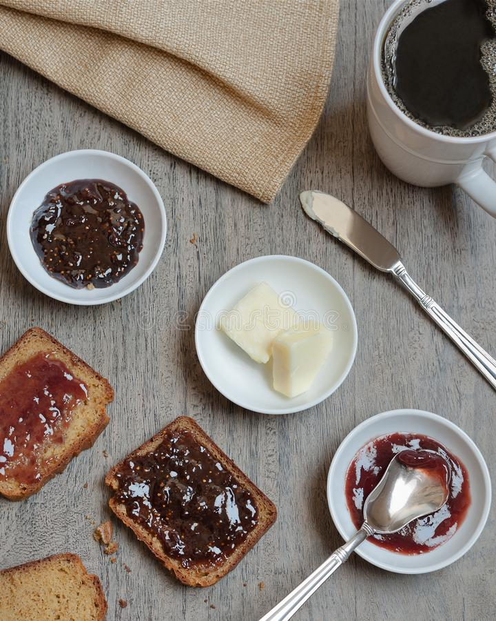 Home made paleo, gluten free bread served with jam, butter and coffee. stock images