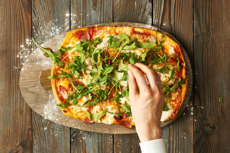 Home made pizza on wooden table royalty free stock photos