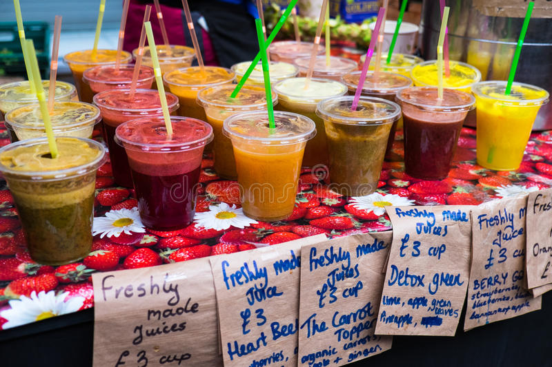 Home made smoothies. For sale at a local farmer's market. London England stock photos