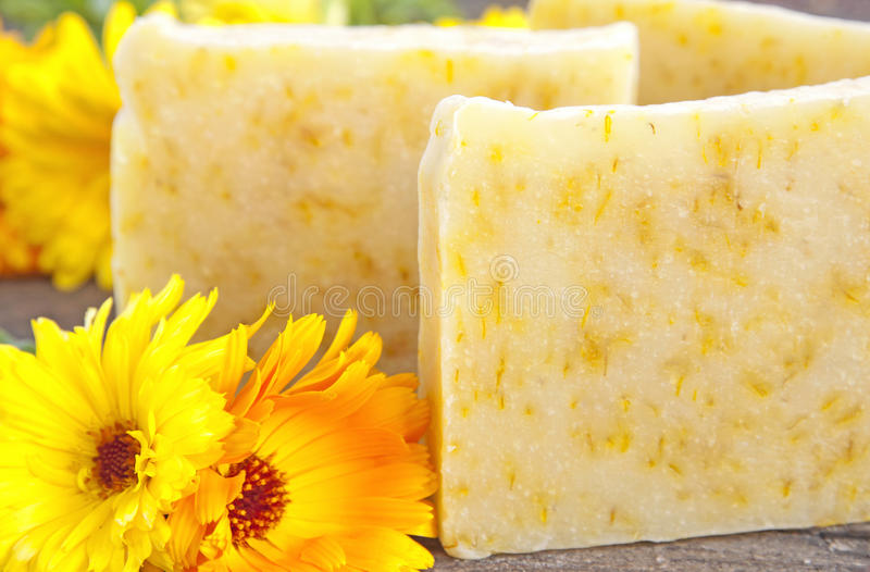 Home-made soap with marigold royalty free stock photos
