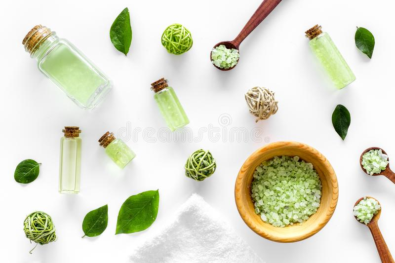 Home made spa cosmetic with tea olive oil and salt for bath on white background top view pattern. Home made spa cosmetic with tea olive oil and salt for bath on stock image