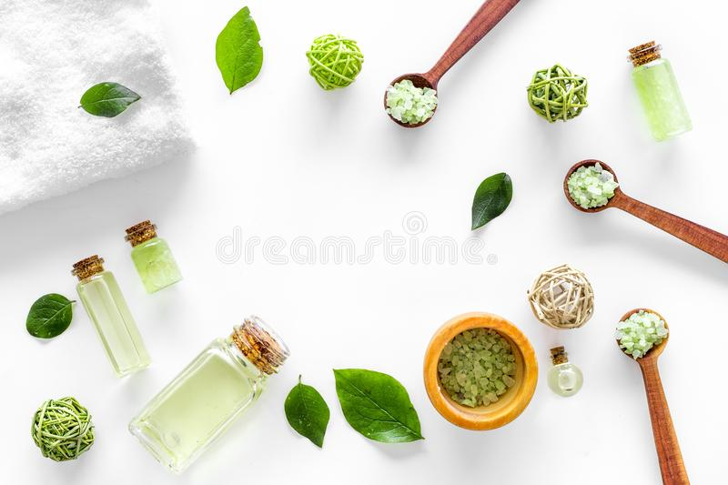 Home made spa cosmetic with tea olive oil and salt for bath on white background top view frame stock photo