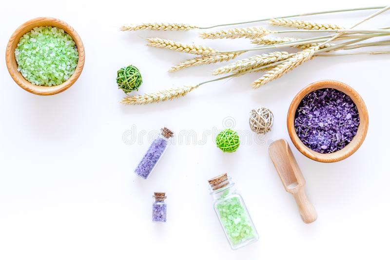 Home spa with wheat herbs cosmetic salt for bath on white desk background top view royalty free stock photo