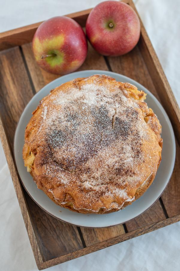 Home made sweet apple pie with red apples. On a table royalty free stock photography