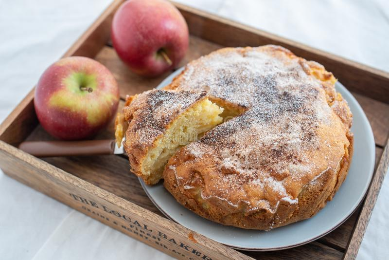 Home made sweet apple pie with red apples. On a table stock photo
