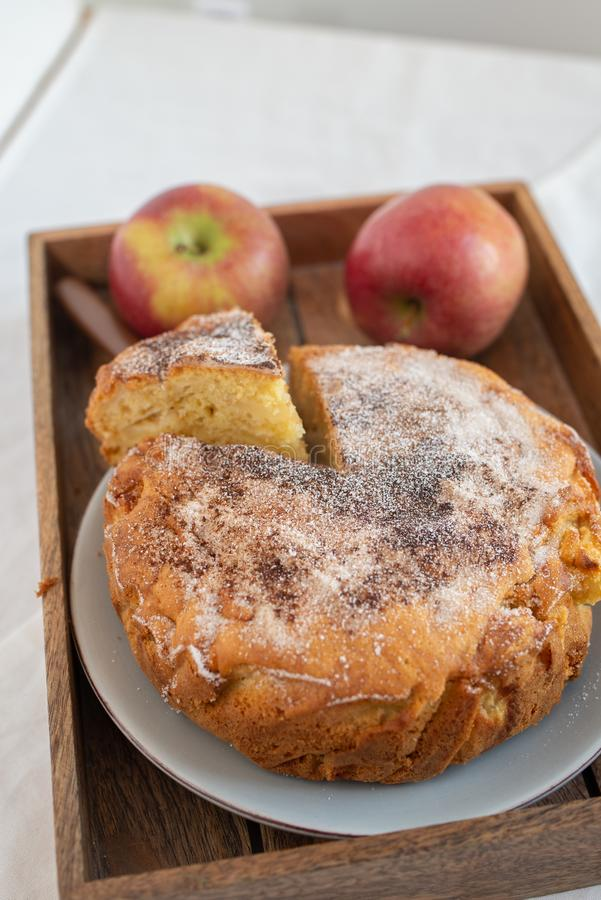 Home made sweet apple pie with red apples. On a table stock photos