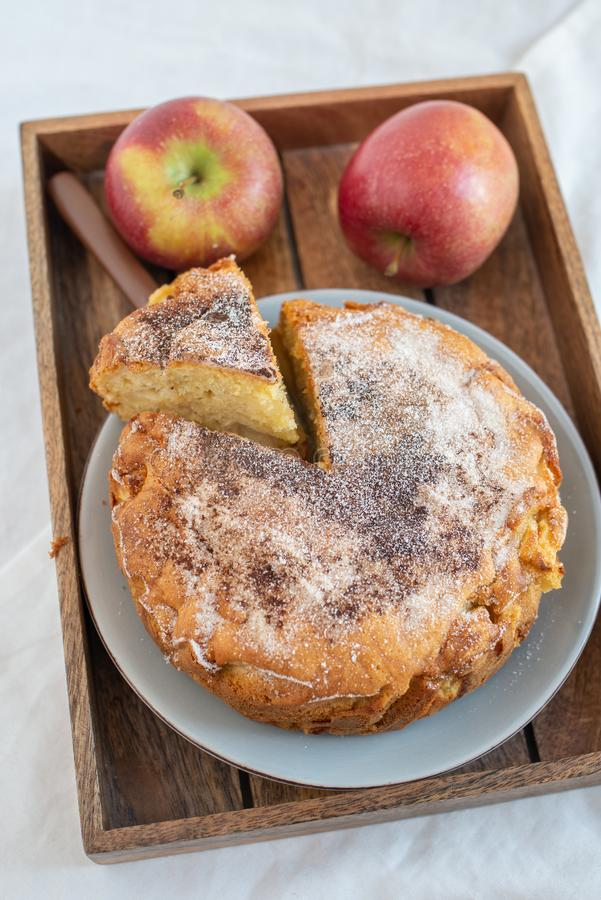 Home made sweet apple pie with red apples. On a table stock images