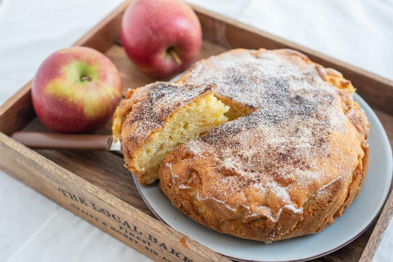 Home made sweet apple pie with red apples. On a table royalty free stock photo