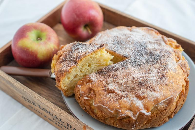 Home made sweet apple pie with red apples. On a table royalty free stock image
