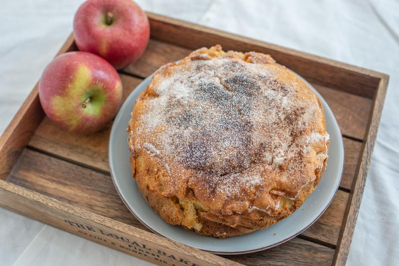 Home made sweet apple pie with red apples. On a table royalty free stock photos