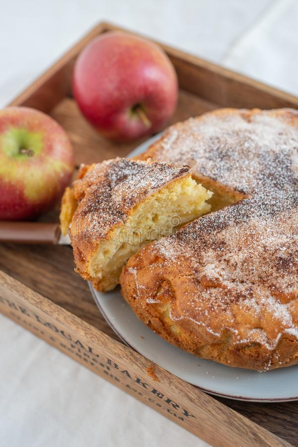 Home made sweet apple pie with red apples. On a table royalty free stock images