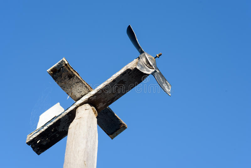 Home Made Wooden Airplane Weather Vane. Homemade wooden airplane weather vane with a blue summer sky royalty free stock photos