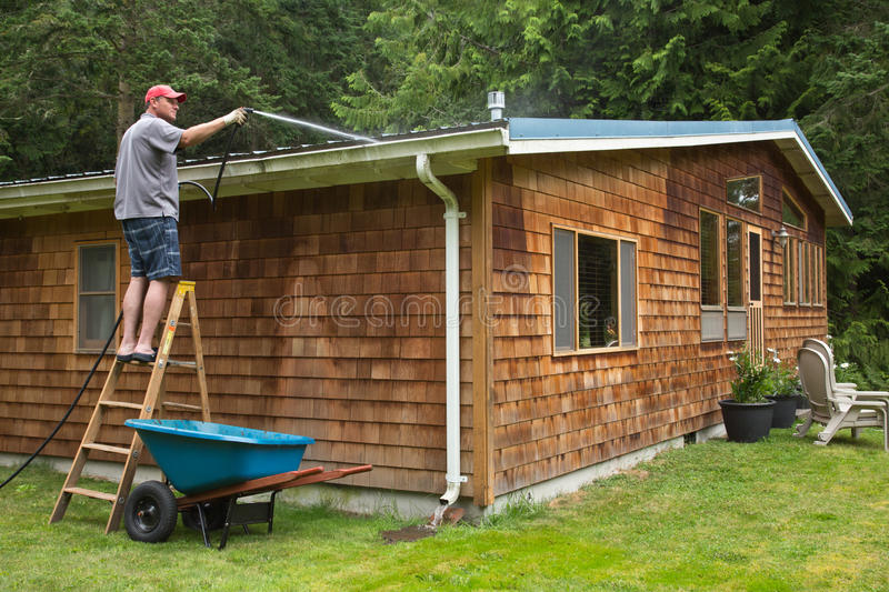 Home Maintenance Cleaning Gutters stock photography