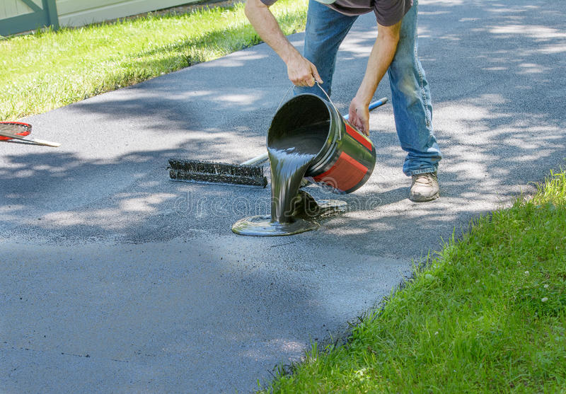 Home maintenance do it yourself driveway resealing stock photo do it yourself driveway resealing stock photo image of blacktopping solutioingenieria Images
