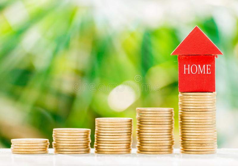 Home model with coins royalty free stock image