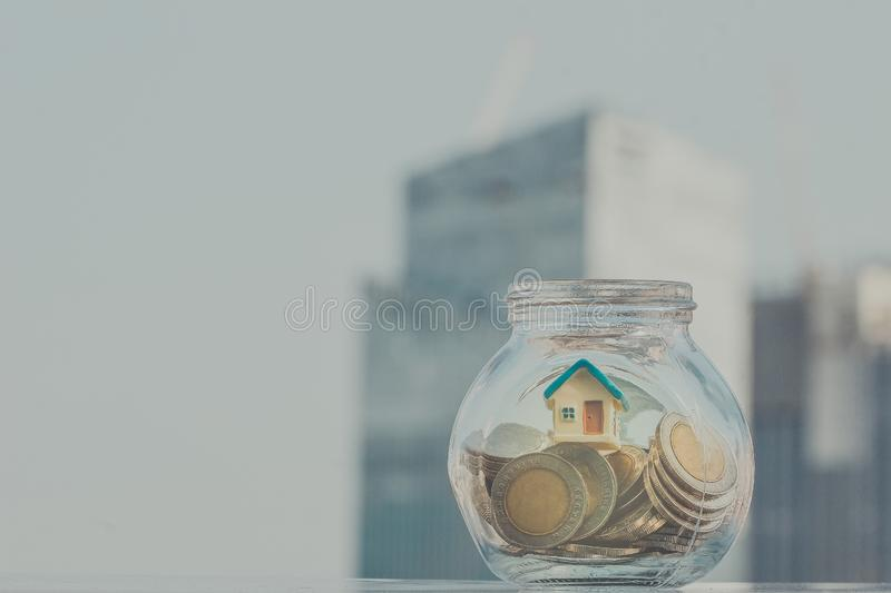 Home model put in the bottle. Business, financial, savings royalty free stock photo