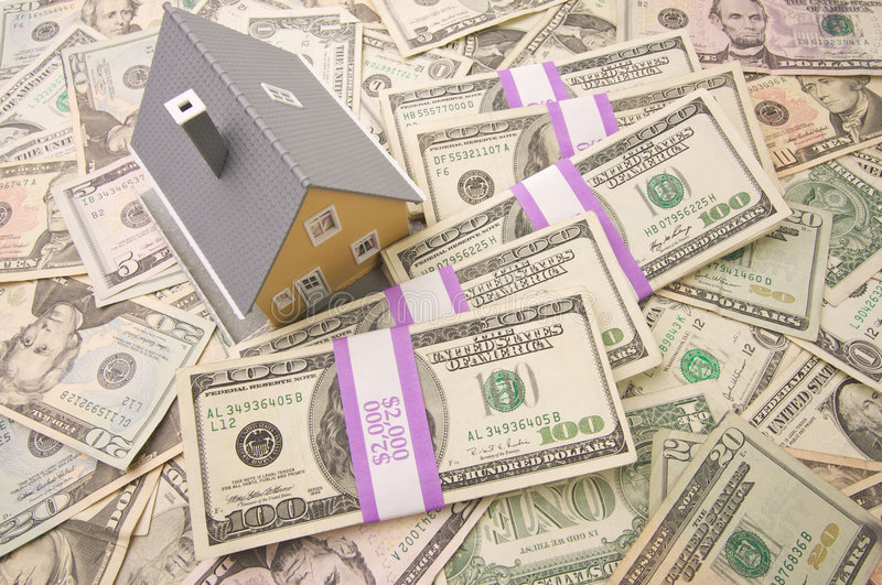 Home and Money. Home with Stacks of Money as Background stock photography