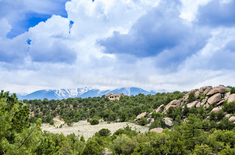 Home in the mountains. A view of the Colorado mountains with a home in the forground stock photo