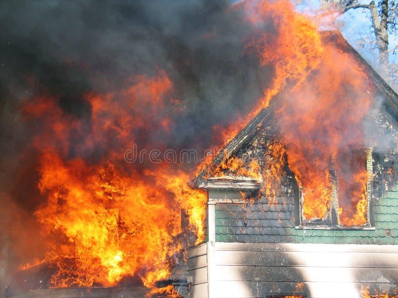 HOME no incêndio imagem de stock royalty free