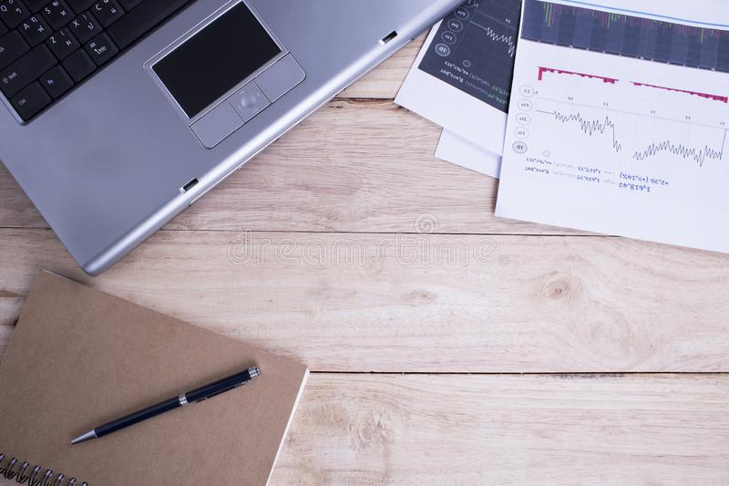 Home office for business, notebook and a stock market and a laptop on the wooden background.  stock images