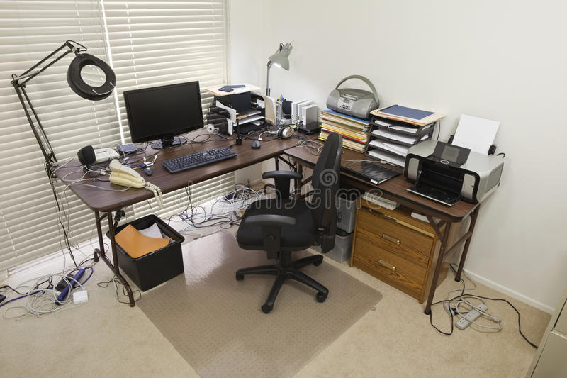 Home Office with Chaotic Cords. Upstairs home office with chaos of cords royalty free stock images