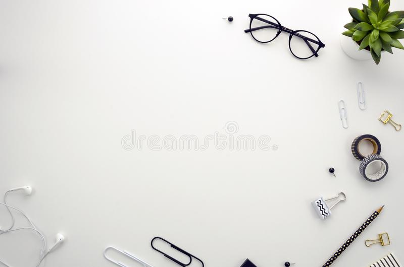 Home office desk workspace with office accessories on white background. Flat lay, top view Home office desk workspace with office accessories including glasses stock photos