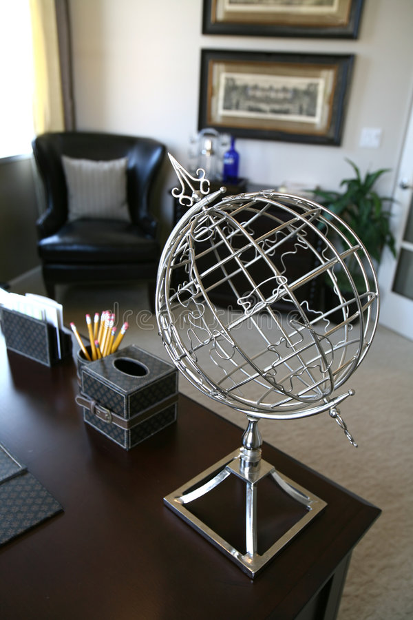 Home Office Interior (Focus on Globe). A wire globe in an home office interior (Focus on Globe royalty free stock photos