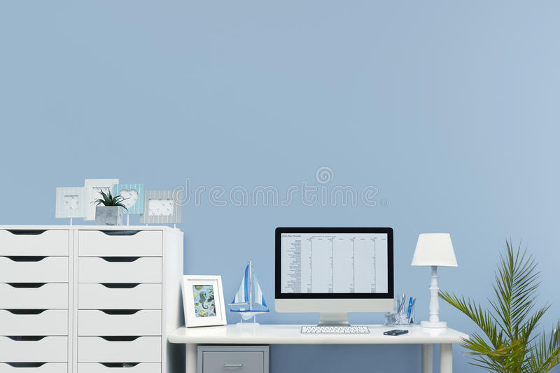 Home office interior set up. Home and Business office interior set up with a mobile phone and desktop computer on a white desk royalty free stock photo