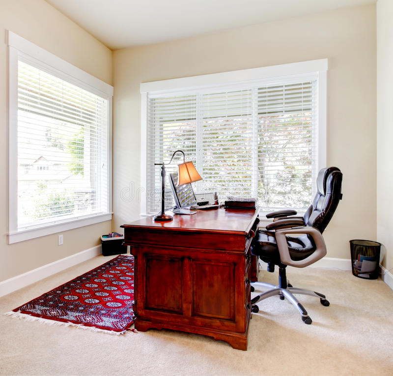Home office with mahogany desk and letaher chair. Home classic office with mahogany desk and letaher chair stock images