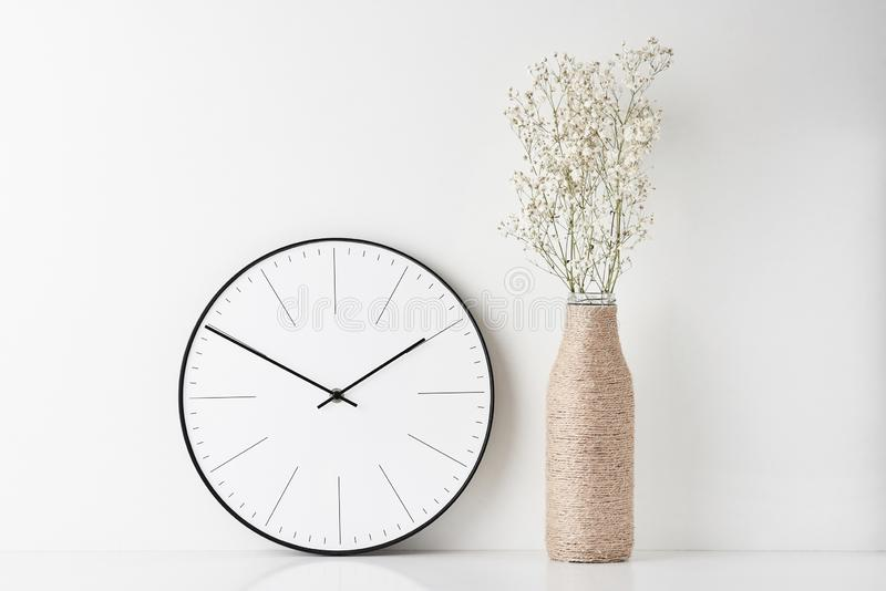 Home office minimal workspace desk with wall clock royalty free stock images
